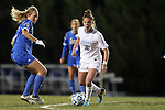 30 November 2013: North Carolina's Joanna Boyles (10) and UCLA's Samantha Mewis (left). The University of North Carolina Tar Heels played the University of California Los Angeles Bruins at Fetzer Field in Chapel Hill, North Carolina in a 2013 NCAA Division I Women's Soccer Tournament Quarterfinal match. UCLA won the game 1-0 in two overtimes.