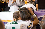 Quarterback Brett Favre #4 of the Green Bay Packers gives his wife, Deanna, a hug after the game during an NFL football game against the Minnesota Vikings at Hubert H. Humphrey Metrodome on September 30, 2007 in Minneapolis, Minnesota. The Packers beat the Vikings 23-16. (Photo by David Stluka)