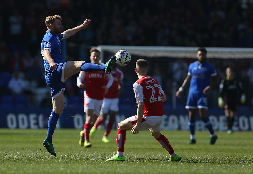 Oldham Athletic's Chris Taylor controls the ball under the watchful eye of Fleetwood Town's Ashley Hunter<br /> <br /> Photographer Stephen White/CameraSport<br /> <br /> The EFL Sky Bet League One - Oldham Athletic v Fleetwood Town - Saturday 8th April 2017 - SportsDirect.com Park - Oldham<br /> <br /> World Copyright &copy; 2017 CameraSport. All rights reserved. 43 Linden Ave. Countesthorpe. Leicester. England. LE8 5PG - Tel: +44 (0) 116 277 4147 - admin@camerasport.com - www.camerasport.com
