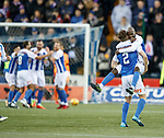 Youssof Mulumbu celebrates with Stephen O'Donnel after Kris Boyd jabbed his wayward shot into the net for Kilmarnock's second goal