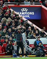 27th November 2019; Anfield, Liverpool, Merseyside, England; UEFA Champions League Football, Liverpool versus SSC Napoli ; Liverpool manager Jurgen Klopp signals to his players as they chase a winning goal during the second half - Editorial Use