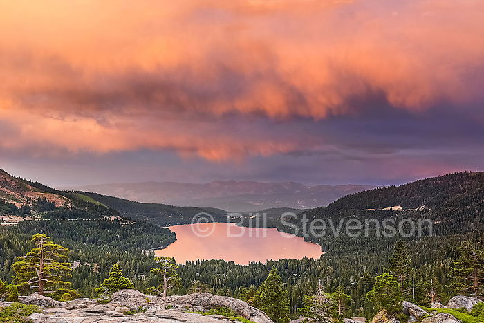One of the best times to ohotograph Donner Lake is when a building storm fills the sky with dramatic clouds at sunset. If youi're lucky there will be a narrow clearing on the western horizon which allows the sun to peek through and paint the clouds with sunset color.