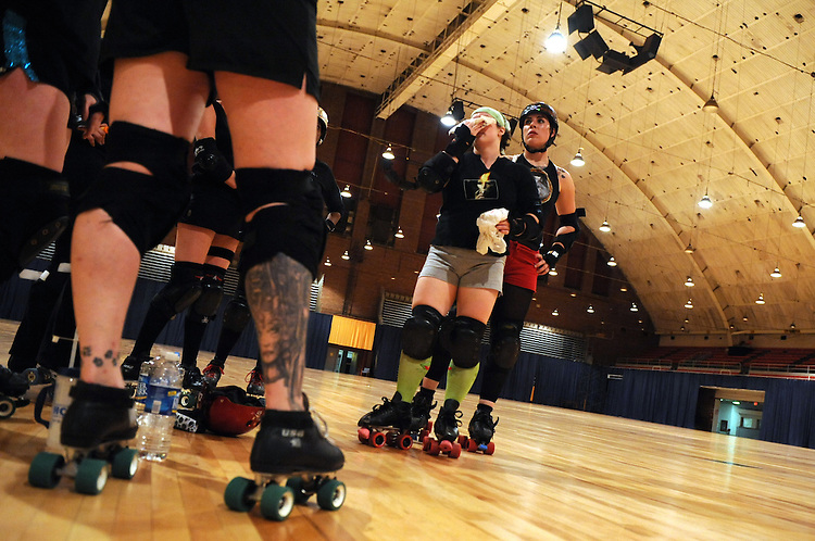 """Darth Vixon,"" Myia Welsh, of team Scare Force One, ices her nose after a collision during a practice of the D.C. Rollergirls at the D.C. Armory.  ""Trampon,"" Jessica Schultz, appears at right, April 22, 2008."