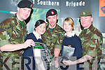 ARMED WITH INFORMATION: Students Marguerite OConnor (l) and Jennifer Buckley (r) from Rathmore Secondary School sought guidence from Pat Murnane (l) Sgt. Dave Locke (m) and Sgt. Tony Fields (r) from Tralee Army Barracks on Thursday at the Careers Fair in the Brandon Hotel. .
