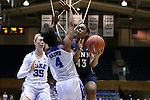 13 November 2016: Penn's Michelle Nwokedi (43) is defended by Duke's Lexie Brown (4) and Erin Mathias (35). The Duke University Blue Devils hosted the University of Pennsylvania Quakers at Cameron Indoor Stadium in Durham, North Carolina in a 2016-17 NCAA Division I Women's Basketball game. Duke defeated Penn 68-55.