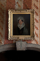 A portrait of Helen Hill against the Bedhouin tent hangings that adorn the walls of the dining room