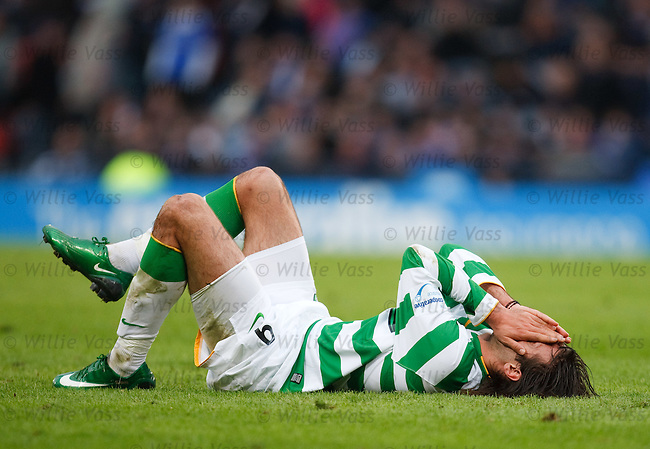 Celtic's Georgios Samaras goes down on the turf as valuable seconds tick by
