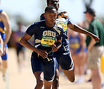 FARGO, ND - MAY 13: Aobkawe Malau from Oral Roberts takes the baton for his leg of the men's 4x400 meter relay Saturday at the 2017 Summit League Outdoor Track Championship at the Ellig Sports Complex in Fargo, ND. (Photo by Dave Eggen/Inertia)
