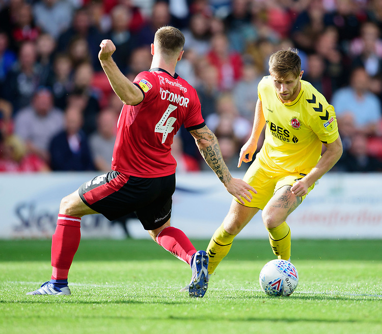 Fleetwood Town's Wes Burns battles with Lincoln City's Michael O'Connor<br /> <br /> Photographer Andrew Vaughan/CameraSport<br /> <br /> The EFL Sky Bet League One - Lincoln City v Fleetwood Town - Saturday 31st August 2019 - Sincil Bank - Lincoln<br /> <br /> World Copyright © 2019 CameraSport. All rights reserved. 43 Linden Ave. Countesthorpe. Leicester. England. LE8 5PG - Tel: +44 (0) 116 277 4147 - admin@camerasport.com - www.camerasport.com