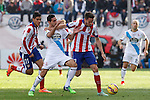 Atletico de Madrid´s Raul Jimenez (L) and Saul Niguez and Deportivo de la Coruña´s Rodriguez during 2014-15 La Liga match between Atletico de Madrid and Deportivo de la Coruña at Vicente Calderon stadium in Madrid, Spain. November 30, 2014. (ALTERPHOTOS/Victor Blanco)