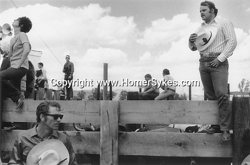 EVANSTON WYOMING   USA 1971. YOUNG PATRIOTIC AMERICANS TAKE OFF THEIR HATS DURING THE PLAYING OF THE NATIONAL ANTHEM AT THE START OF A RODEO.