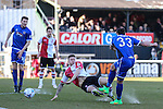 Ollie Palmer of Grimsby Town shoots under pressure from the Woking defence during the Vanamara Conference League match between Woking and Grimsby Town at the Kingfield Stadium, Woking, Surrey<br /> Picture by David Horn/eXtreme aperture photography +44 7545 970036<br /> 07/03/2015