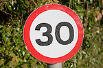Thirty miles per hour red circular speed limit sign, UK