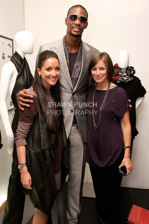 Miami Heat Chris Bosh poses with, Jessica Rae Someck (Left) and Kira Kohrherr (right) of K Public Relations, at the Blanc de Chine Spring/Summer 2012 fashion show cocktail reception, during New York Fashion Week Spring 2012, September 10, 2011.