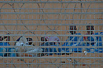 Eritrean immigrants are seen behind the newly-built fence in Israel-Egypt border, after they arrived a week earlier at the spot, crossed the old fence but got trapped by the new one. Israeli soldiers have been providing the group with water, but not allowing them into Israel.<br />