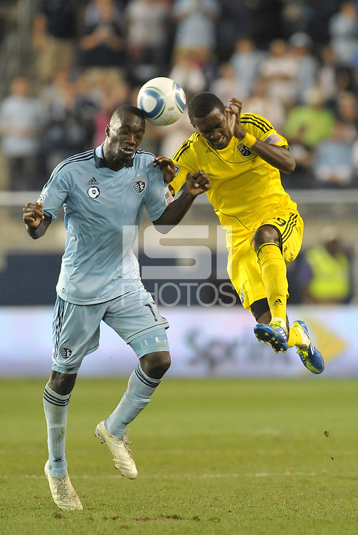 C.J Sapong (17) forward Sporting KC goes for a header against Shaun Francis (29) Columbus Crew... Sporting Kansas City defeated Columbus Crew 2-1 at LIVESTRONG Sporting Park, Kansas City, Kansas.