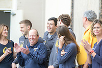 BERKELEY, CA - Feb. 18, 2017: Cal's Long Gutierrez (center) smiles after being introduced with his parents on Senior Day.  Cal Men's Swimming and Diving competed against Stanford at Spieker Aquatics Complex.
