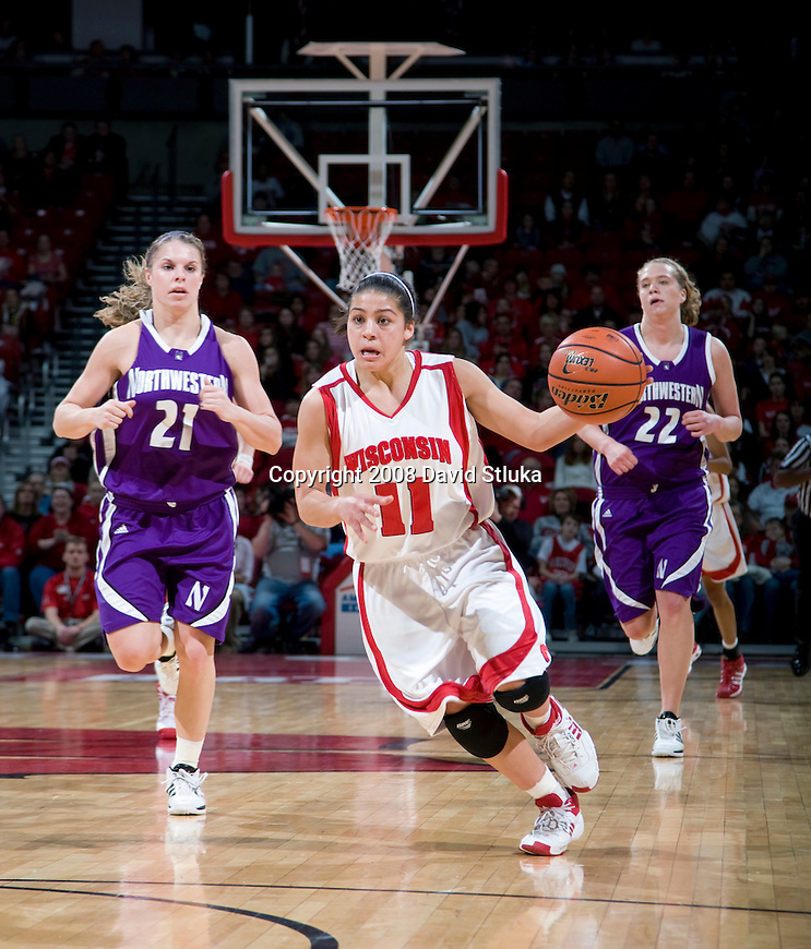 MADISON, WI - JANUARY 27: Guard Rae Lin D'Alie #11 of the Wisconsin Badgers women's basketball team handles the ball against the Northwestern Wildcats at the Kohl Center on January 27, 2008 in Madison, Wisconsin. Wisconsin beat Northwestern 75-45. (Photo by David Stluka)