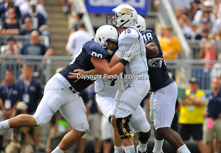 06 September 2014:  Penn State DT Anthony Zettel (98) hits Akron QB Kyle Pohl (16). The Penn State Nittany Lions defeated the Akron Zips 21-3 at Beaver Stadium in State College, PA.