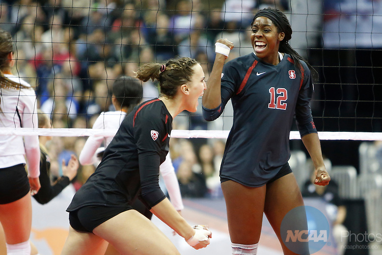 COLUMBUS, OH - DECEMBER 17:  Inky Ajanaku (12) of Stanford University reacts to a point against the University of Texas during the Division I Women's Volleyball Championship held at Nationwide Arena on December 17, 2016 in Columbus, Ohio.  Stanford beat Texas 3-1 to win the national title.  (Photo by Jay LaPrete/NCAA Photos via Getty Images)