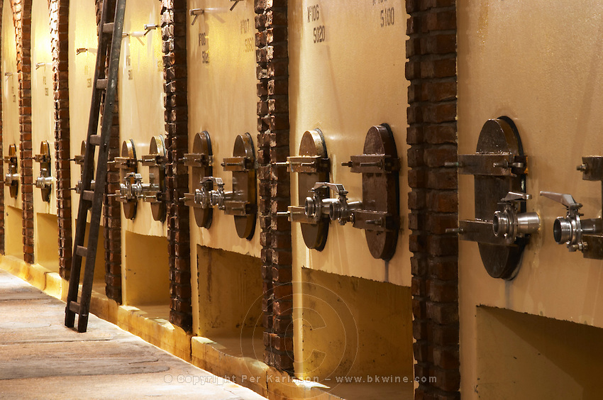 Concrete fermentation tanks and a ladder, Bodega Castillo Viejo Winery, Las Piedras, Canelones, Uruguay, South America