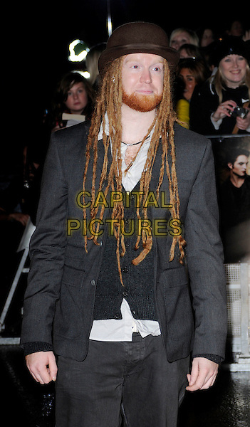 "NEWTON FAULKNER .Attending ""The Twilight Saga: New Moon"" Fan Event at the Battersea Evolution, London, England, UK, November 11th 2009..half length grey gray brown hat suit jacket beard facial hair dreadlocks .CAP/CAN.©Can Nguyen/Capital Pictures."