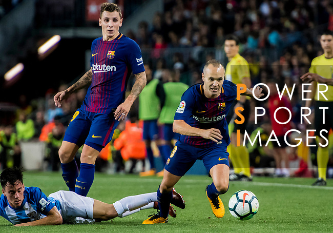 Andres Iniesta Lujan of FC Barcelona fights for the ball with Juan Pablo Anor Acosta, Juanpi (l), of Malaga CF during the La Liga 2017-18 match between FC Barcelona and Malaga CF at Camp Nou on 21 October 2017 in Barcelona, Spain. Photo by Vicens Gimenez / Power Sport Images