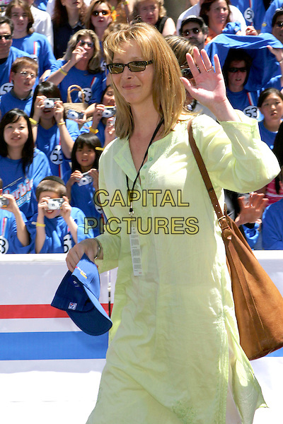 "LISA KUDROW.World Premiere of ""Herbie Fully Loaded"" held at the .El Capitan Theatre, Hollywood, CA, USA,.19 June 2005..half length waving sunglasses green top big large brown bag.Ref: ADM.www.capitalpictures.com.sales@capitalpictures.com.©Jacqui Wong/AdMedia/Capital Pictures."