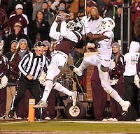 NWA Media/Michael Woods --11/01/2014-- w @NWAMICHAELW... Mississippi State defender Will Redmond goes up to make an interception in the end zone in front of Arkansas receiver Demetrius Wilson in the final seconds of the 4th quarter of Saturday nights game against Mississippi State at Davis Wade Stadium in Starkville, Mississippi.