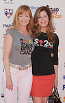 LOS ANGELES, CA - SEPTEMBER 07: Marg Helgenberger and Dana Delany arrive at Stand Up To Cancer at The Shrine Auditorium on September 7, 2012 in Los Angeles, California.