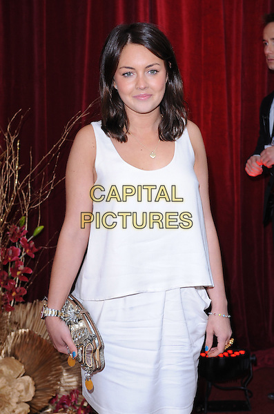 LACEY TURNER.Arrivals at the British Soap Awards 2010, London Television Centre, London, England..May 8th, 2010.half length white cream tiered sleeveless dress gold clutch bag .CAP/BEL.©Tom Belcher/Capital Pictures.