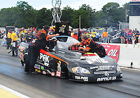 Aug. 19, 2011; Brainerd, MN, USA: NHRA crew members for funny car driver Dale Creasy Jr during qualifying for the Lucas Oil Nationals at Brainerd International Raceway. Mandatory Credit: Mark J. Rebilas-