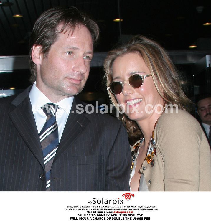 "ALL ROUND PICTURES FROM SOLARPIX.COM..David Duchovny with wife Tea Leoni - Trust The Man New York Movie Premiere - Chelsea West Cinema - New York, NY..DATE: 07/08/2006-JOB REF: 2703-PHZ..""MUST CREDIT SOLARPIX.COM OR DOUBLE FEE WILL BE CHARGED"""