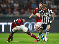 Calcio, Serie A: Milan vs Juventus, Milano, stadio San Siro, 20 settembre 2014.<br /> Juventus forward Fernando Llorente, of Spain, right, is challenged by AC Milan defender Cristian Zapata, of Colombia, during the Italian Serie A football match between AC Milan and Juventus at Milan's San Siro stadium, 20 September 2014.<br /> UPDATE IMAGES PRESS/Isabella Bonotto