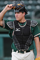 Catcher Jacob Realmuto (11) of the Greensboro Grasshoppers, Class A affiliate of the Florida Marlins, in a game against the Greenville Drive on April 25, 2011, at Fluor Field at the West End in Greenville, S.C. Photo by Tom Priddy / Four Seam Images