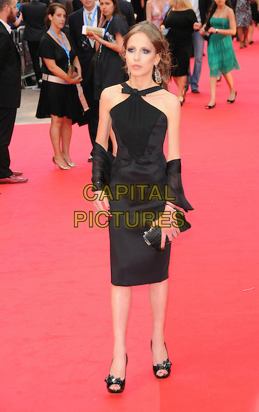 """ALLEGRA VERSACE .Attends the Batman movie """"The Dark Knight"""" UK Premiere, Odeon Leicester Square, London, England,.July 21st 2008..full length Beck black dress skinny thing anorexic shoes heels halterneck open toe wrap clutch bag.CAP/CAS.©Bob Cass/Capital Pictures"""
