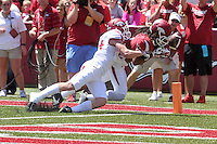 NWA Democrat-Gazette/Michael Woods --04/25/2015--w@NWAMICHAELW... University of Arkansas receiver Keon Hatcher looses control of the ball as he is hit by defender Ryder Lucas during the 2015 Red-White game Saturday afternoon at Razorback Stadium in Fayetteville.