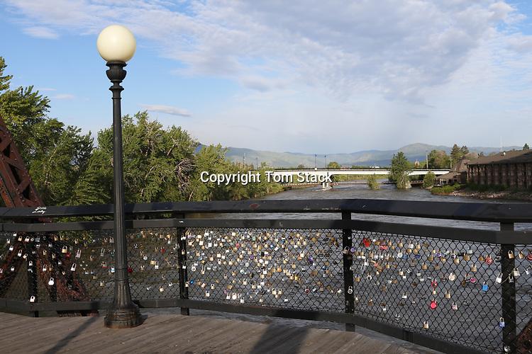 Love locks on the landmark Van Buren Footbridge over the Clark Fork River to the campus of the University of Montana in Missoula, Montana.