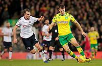 Norwich City's Christoph Zimmermann gets away from Bolton Wanderers' Christian Doidge<br /> <br /> Photographer David Shipman/CameraSport<br /> <br /> The EFL Sky Bet Championship - Norwich City v Bolton Wanderers - Saturday 8th December 2018 - Carrow Road - Norwich<br /> <br /> World Copyright &copy; 2018 CameraSport. All rights reserved. 43 Linden Ave. Countesthorpe. Leicester. England. LE8 5PG - Tel: +44 (0) 116 277 4147 - admin@camerasport.com - www.camerasport.com