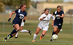 BROOKINGS, SD - OCTOBER 12: Lauren Kressock #5 from South Dakota State pushes the ball between Hannah Briggs #34 and Maria Stordahl #28 from Oral Roberts University in the first half of their game Sunday afternoon at Fischback Soccer Field in Brookings. (Photo by Dave Eggen/Inertia)