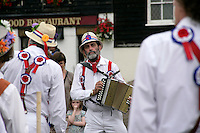 Concertina player with morris dancers at Broadstairs, Kent, UK