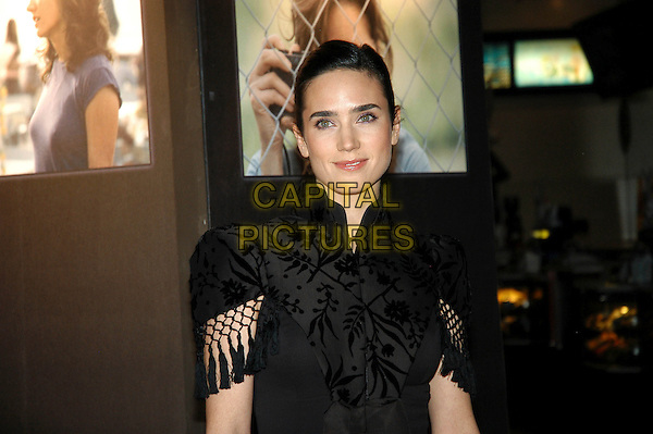 "JENNIFER CONNELLY.""Blood Diamond"" photocall at Cinema Warner Moderno, Rome, Italy..half length black dress mandarin collar tassels bow .January 24th, 2007.CAP/CAV.©Luca Cavallari/Capital Pictures"