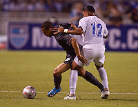 Charlie Davies dribbles the ball against Emilio Izaguirre (12). US Men's National Team vs Honduras at Estadio Olimpico in San Pedro Sula, Honduras.