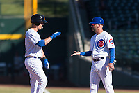 Mesa Solar Sox shortstop Nico Hoerner (17), of the Chicago Cubs organization, is congratulated by hitting coach Jesus Feliciano (22) after getting a hit during an Arizona Fall League game against the Surprise Saguaros at Sloan Park on November 15, 2018 in Mesa, Arizona. Mesa defeated Surprise 11-10. (Zachary Lucy/Four Seam Images)