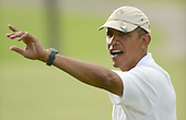 United States President Barack Obama waves to a waiting crowd at the 18th hole at the Mid Pacific Country Club in Lanikai, Hawaii on January 1, 2014.<br /> Credit: Cory Lum / Pool via CNP