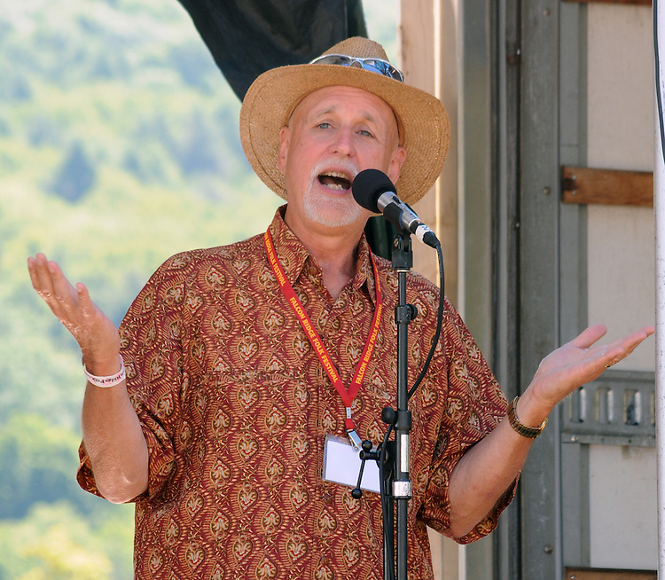 "John Platt, of WFUV, announcing the start of the 'Gospel Wake Up Call"" Show, at the  Main Stage of the Falcon Ridge Folk Festival, held on Dodd's Farm in Hillsdale, NY on Sunday, August 2, 2015. Photo by Jim Peppler. Copyright Jim Peppler 2015."