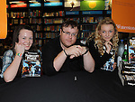 Kerry Brady and Summer Morgan pictured with author Derek Landy at his book signing in Waterstones at Scotch Hall. Photo: Colin Bell/pressphotos.ie