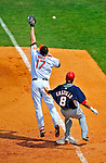 6 March 2009: Washington Nationals' infielder Jose Castillo is safe at first as the throw sails beyond the reach of Aubrey Huff during a Spring Training game against the Baltimore Orioles at Fort Lauderdale Stadium in Fort Lauderdale, Florida. The Orioles defeated the Nationals 6-2 in the Grapefruit League matchup. Mandatory Photo Credit: Ed Wolfstein Photo
