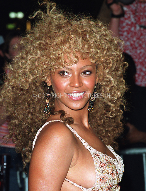 "Beyonce Knowles arriving at the New York Premiere of ""Austin Powers in Goldmember"" at Barney's New York on Madison Avenue in New York. July 24, 2002. Please byline: Alecsey Boldeskul/NY Photo Press.   ..*PAY-PER-USE*      ....NY Photo Press:  ..phone (646) 267-6913;   ..e-mail: info@nyphotopress.com"