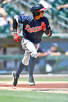 Gwinnett Braves third baseman Johan Camargo (2) runs to first base during a game against the Charlotte Knights at BB&T Ballpark on May 7, 2017 in Charlotte, North Carolina. The Knights defeated the Braves 7-1. (Tony Farlow/Four Seam Images)
